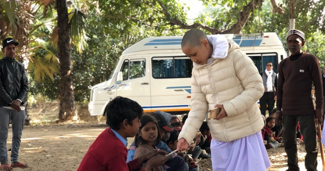 A Buddhist nun and Indian villagers